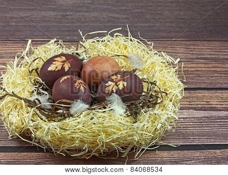 Nest With Easter Eggs On Wooden Background