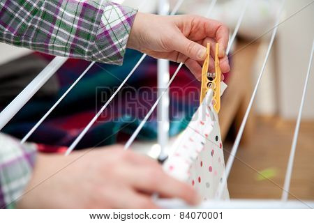 Woman Hanging Laundry To Laundry Stand