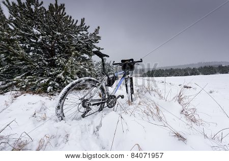 Bike Off The Trail Buried In Snow In Winter Scenery