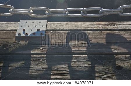 Abstract shadow and metal chain
