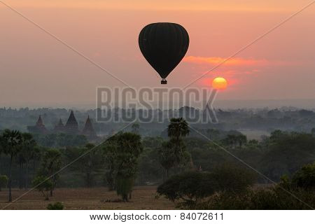 air balloons over Buddhist temples at sunrise. Bagan Myanmar.