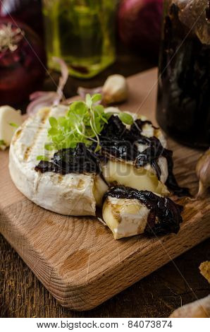 Toasted Bread With Brie Cheese And Caramelized Onions