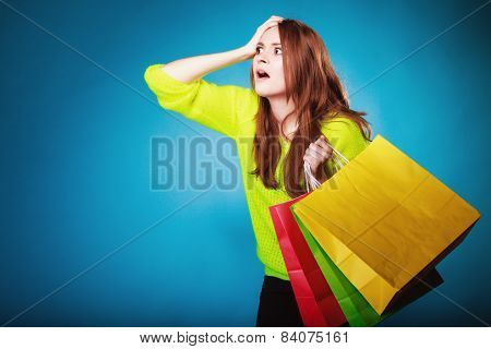 Emotional Woman With Paper Shopping Bags On Blue.