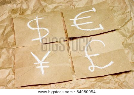 Dollar, Euro, Pound And Yen Currency Icons On Paper. Usd, Eur, Gbp And Jpy Symbols Money Sign.