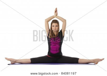 Beautiful blue-eyed woman practices yoga at camera