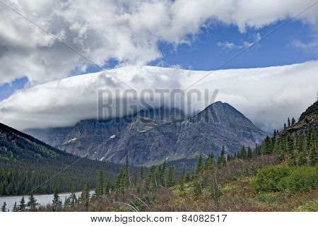 Lake Josephine With Mountains Capped With Clouds