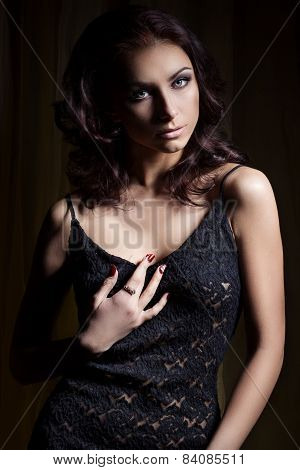 young beautiful sexy girl with a gentle makeup and beautiful hair in a black lace dress with dark