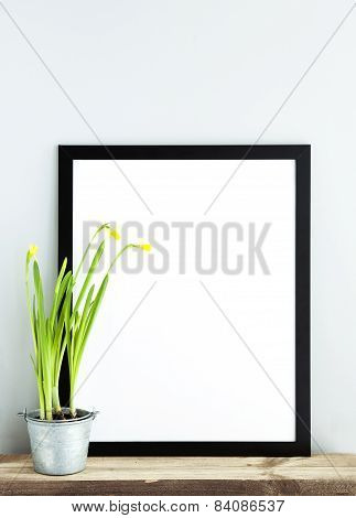 Black Frame With Place For Text  With Potted Narcissus. Scandinavian Hipster Style Room Interior.