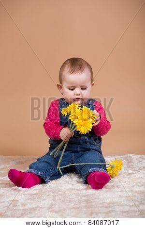 Infant Baby With Yellow Flowers