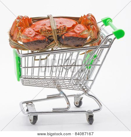 Hairy crabs on the shopping cart isolated in white background.