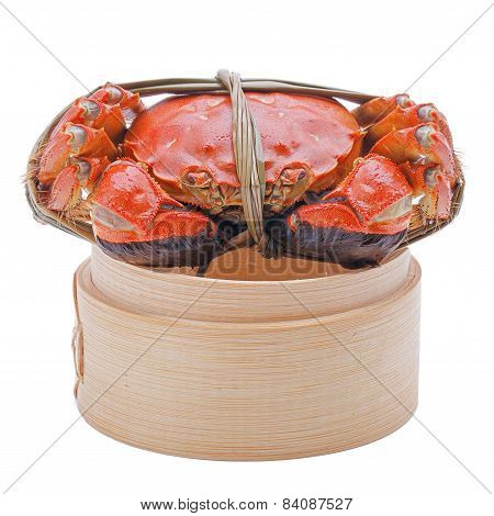 Hairy crabs on the Bamboo steamer Isolated in white background.
