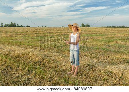 Teenage Farmer Holding Bundle Of Straw