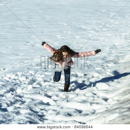 Cute Teenage Girl Playing In White Snow
