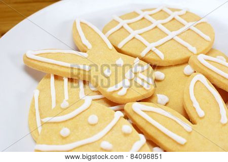 Close Up Of Frosted Easter Cookies On A Plate