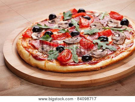 Delicious Fresh Pizza With Ham Served On A Wooden Table