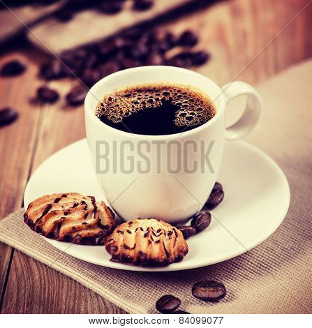 Cup Of Coffee And Cookies On The Table. Vintage Retro Hipster Style Version