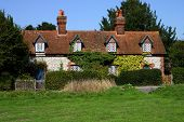 A row of medieval cottages poster