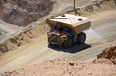 picture of porphyry  - Giant Water Truck Suppressing Dust at Copper Mine - JPG