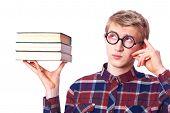 stock photo of nerd glasses  - Nerd guy  in glasses with books - JPG