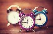 pic of analog clock  - Retro alarm clocks on a table - JPG