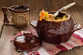 stock photo of stew pot  - Pot of stewed chicken and vegetables - JPG