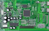 picture of transistor  - Printed computer motherboard with microcircuit close up