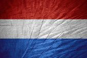 stock photo of holland flag  - Holland flag or Dutch banner on wooden texture - JPG