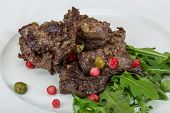 pic of deer meat  - Roasted venison meat with ruccola and cranberries - JPG