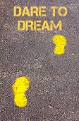 pic of daring  - Yellow footsteps on sidewalk towards Dare to Dream message - JPG
