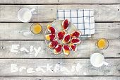 pic of orange-juice  - Easy breakfast quotes top view of white wood table with breakfast sandwiches milk and orange juice - JPG
