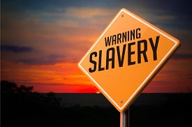 pic of slavery  - Slavery on Warning Road Sign on Sunset Sky Background - JPG