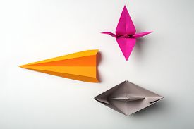 image of float-plane  - front photo of colored paper origami plane crane - JPG