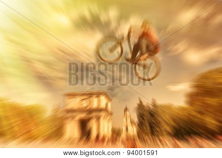 Abstract Background . Boy On A Bmx Mountain Bike Jumping. Motion Blur Photo. Competition In Kishinev