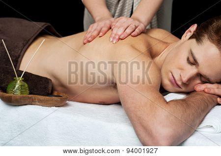 Lying Man Getting A Back Massage