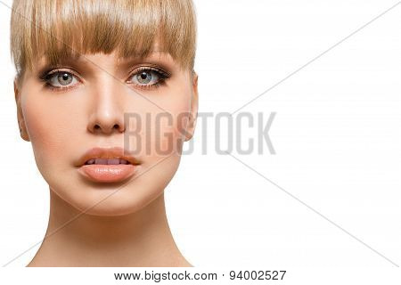 Face of a beautiful young woman close up on a white background