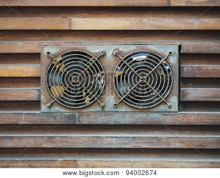 Ventilation Fan With Old Condition on Wooden Wall Background