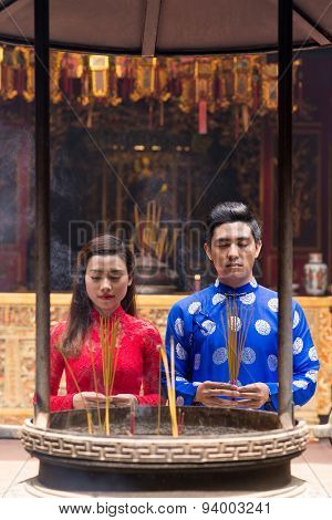 Asian Couple In Buddhist Temple