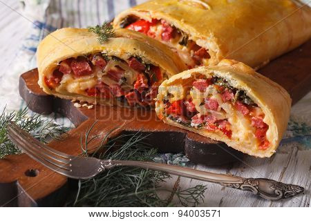 Strudel With Ham, Cheese And Vegetables Closeup. Horizontal