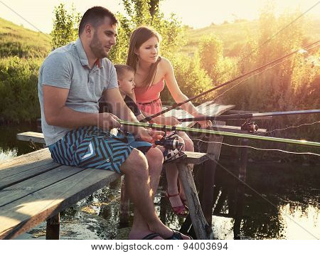Young Family Fishing Holiday With Wooden Planked Footway