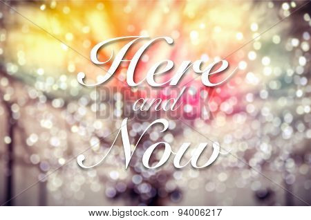 Here Now Typography On Bokeh Background