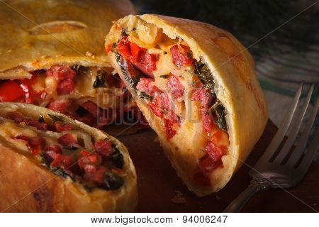 Strudel With Ham, Cheese And Vegetables Macro. Horizontal