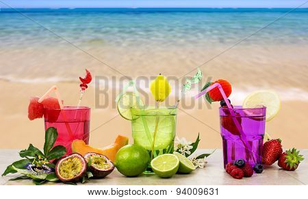 Exotic Fruits Cocktail Against Beachshore Background