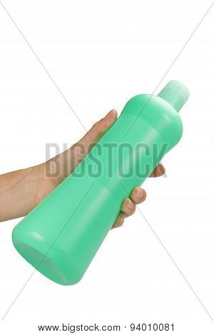 Female Hand Is Holding A Green Plastic Bottle