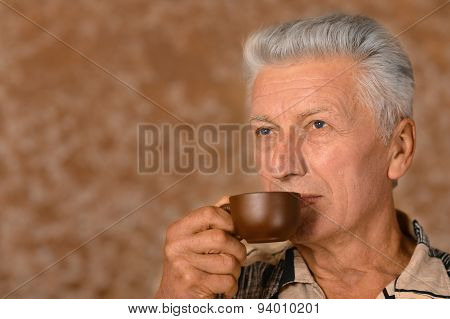Senior man drinking cup of coffee