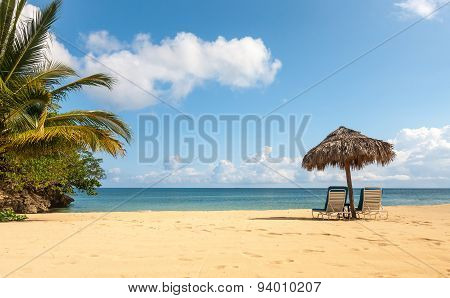 Sunbed and umbrella on a tropical beach