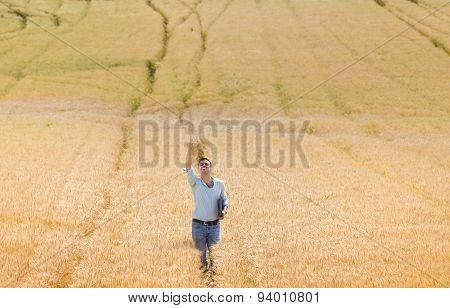 Happy Farmer In Barley Field