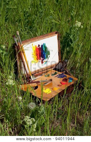 Painter's Case With Abstract Painting On The Grass