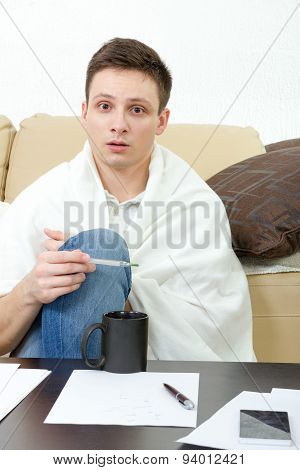 Ill Male Student  Having Headache Covered With White Blanket.