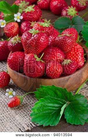 Fresh Strawberries in Wooden Bowl