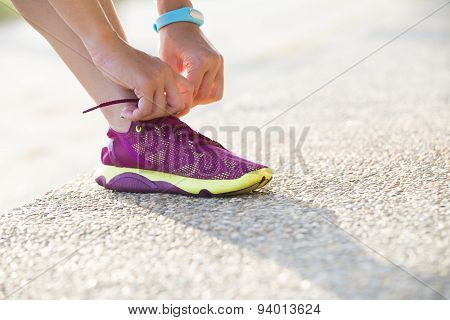 Woman wearing running shoes on the park